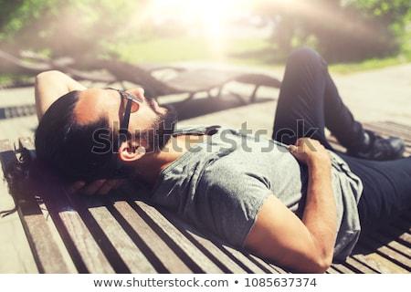 幸せ 男 通り ベンチ 太陽 ベッド ストックフォト © dolgachov