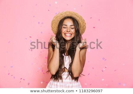csinos · barna · hajú · visel · szalmakalap · néz · kamera - stock fotó © deandrobot