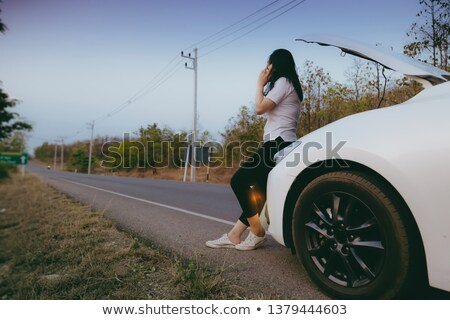 Woman waits for roadside assistance Stock photo © Nobilior