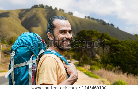 close up of man with backpack over big sur hills Stock photo © dolgachov