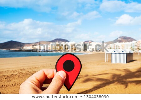 man with a red marker at playa del ingles spain stock photo © nito
