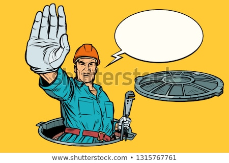 gesture stop plumber in the manhole stock photo © studiostoks