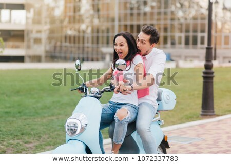 portrait of european couple man and woman riding on motorbike t stock photo © deandrobot