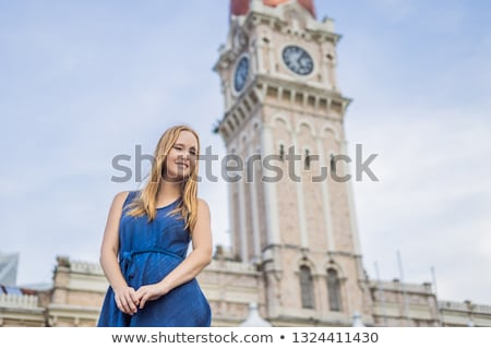 Young woman on background of Sultan Abdul Samad Building in Kuala Lumpur, Malaysia. Traveling with c Stock photo © galitskaya