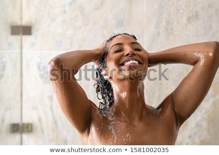 Femme longtemps chaud douche lavage Photo stock © lightpoet