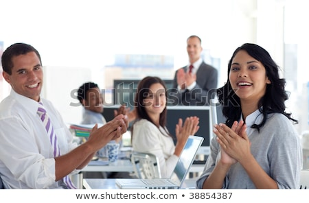coworkers applauding a colleague after presentation stock photo © andreypopov