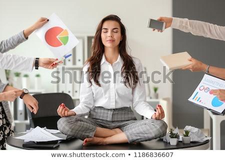 jóvenes · mujer · de · negocios · meditando · oficina · sesión · loto - foto stock © andreypopov