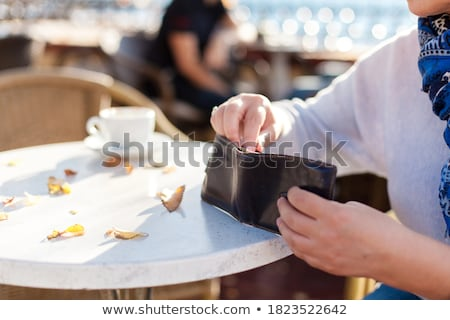 senior woman with wallet paying bill at cafe Stock photo © dolgachov