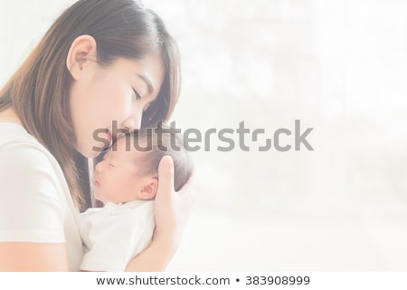 Stock photo: happy young asian mother with little baby at home