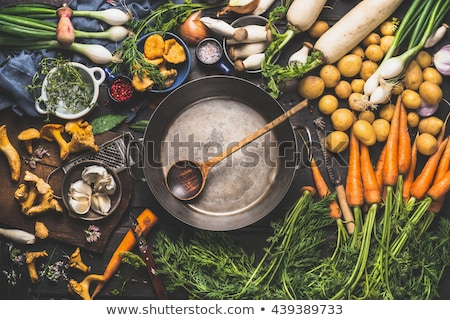Various organic vegetables ingredients around empty pot . Stock photo © Illia