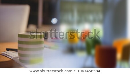 Green coffee cup on desk and blurry office transition Stock photo © wavebreak_media