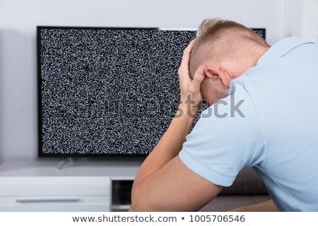 Férfi televízió nem jel ül kanapé Stock fotó © AndreyPopov