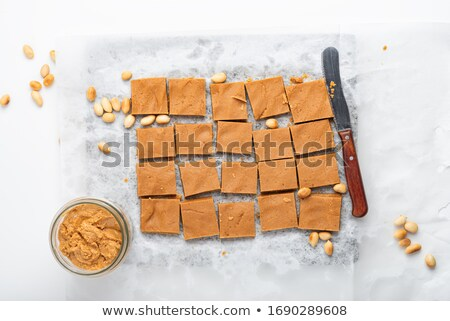 Squares of Delicious Homemade Peanut Butter Fudge with Knife Stock photo © StephanieFrey