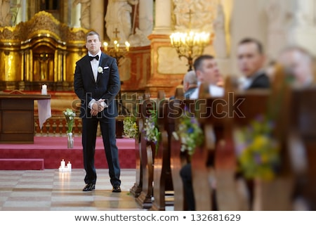 the groom waits for the bride and holds in hands a beautiful wedding bouquet stock photo © ruslanshramko