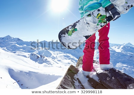 A pair of snowboarders standing on the slope. Stock photo © ConceptCafe