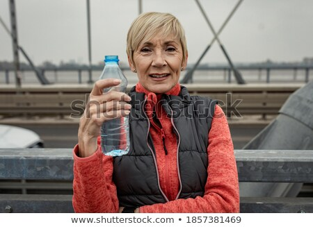 Woman resting from jogging or sport on winter day Stock photo © Kzenon