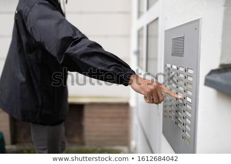 Férfi áll ház bejárat hátsó nézet kezek Stock fotó © AndreyPopov