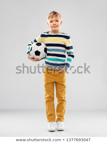 boy in striped pullover with soccer ball Stock photo © dolgachov