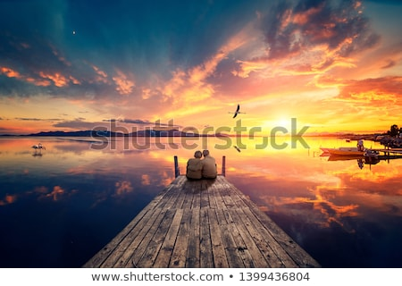 Scenic sunset and reflections on lake with old jetty  Stock photo © lovleah