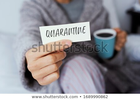 man showing a note with the word quarantine in it Stock photo © nito