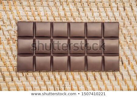 Finom csokoládé szelet szalmaszál csokoládé bár fehér Stock fotó © galitskaya