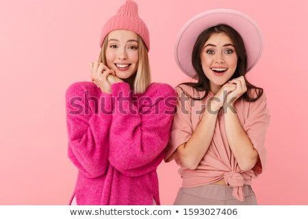Image of young women in girlish clothes smiling and expressing d Stock photo © deandrobot