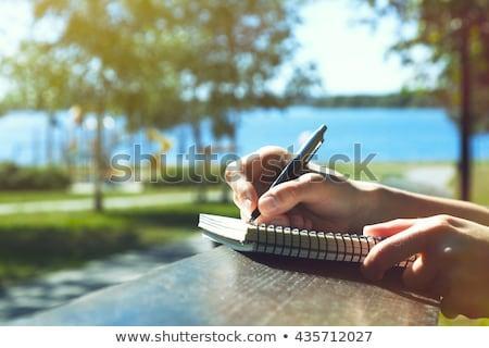 Schriftlich Schönschreibheft ziemlich Mädchen Sitzung Stock foto © pressmaster