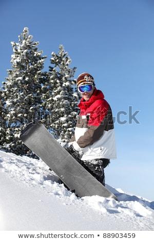 Snowbordos küszködik tábla felfelé hegy égbolt Stock fotó © photography33