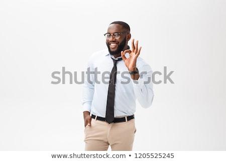 Vriendelijk zakenman tonen teken witte Stockfoto © dolgachov