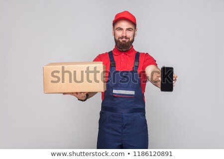 Stock photo: handyman holding a red sign
