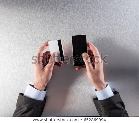 Businessman holding out his business card Stock photo © photography33
