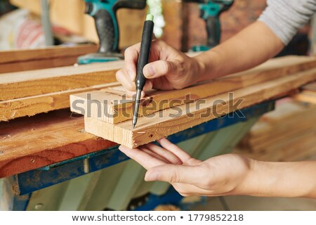 Man marking plank before cutting it Stock photo © photography33