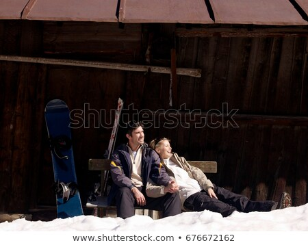 woman all smiles at ski resort with snow in hands stock photo © photography33