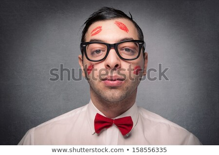 young man with the imprint of a kiss on the face Stock photo © ambro
