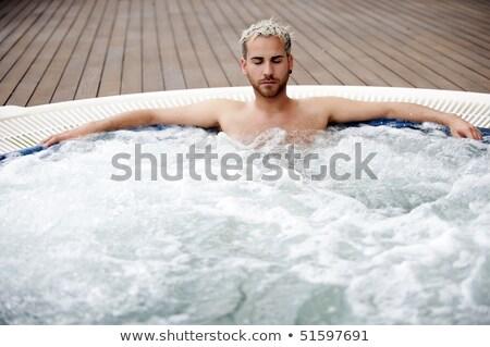 молодым человеком джакузи молодые человека Spa Сток-фото © Kurhan