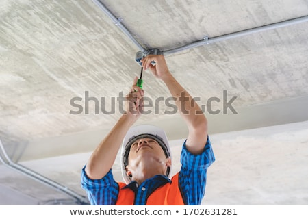 Electrician wiring a ceiling light Stock photo © photography33