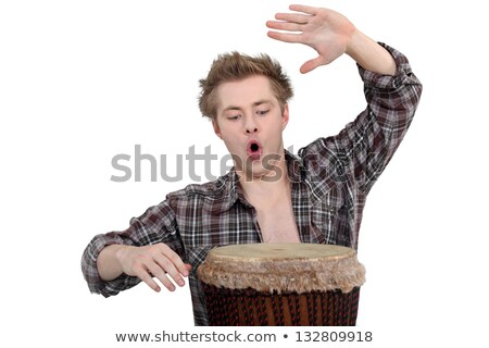 Enthusiastic man playing the bongo drum Stock photo © photography33