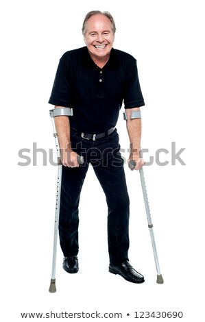 Wypadku ofiara uśmiechnięta kobieta spaceru pomoc kule kalekiego Zdjęcia stock © stockyimages