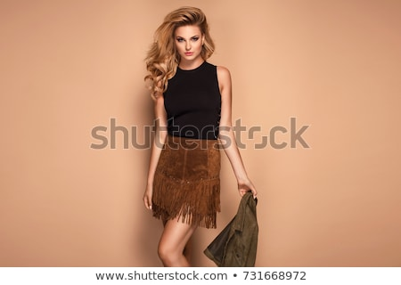 Smiling long haired blond woman posing Stock photo © dash