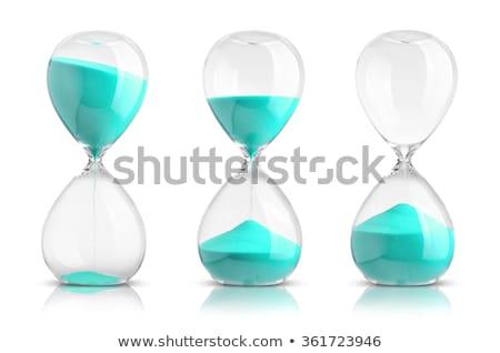 Blue sand-glass isolated on white background Stock photo © ozaiachin