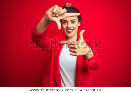 Smiling young female making frame shape with hand stock photo © pablocalvog