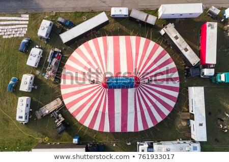 Stock photo: Circus trucks in field
