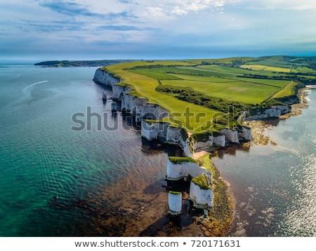 vieux · roches · côte · coucher · du · soleil · paysage · mer - photo stock © flotsom