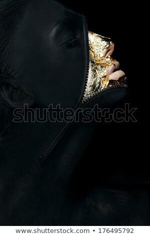 Creative Concept. Surreal Fancy Woman Painted Black with Zip Fastener on her Outlandish Face Stock photo © gromovataya