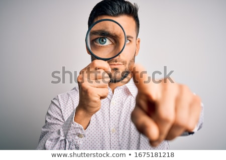serious young man looks at you stock photo © feedough