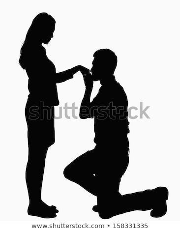 Young man standing on a knee and kissing woman's hand Stock photo © Nejron