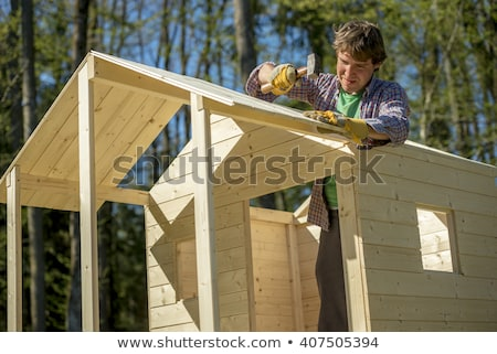 Mallet with nails and planks of new wood Stock photo © juniart