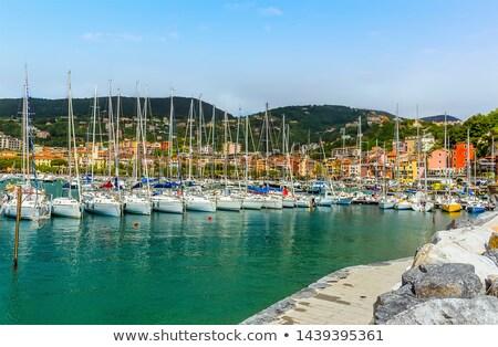Gün batımı liman kale güneş yansıma tekneler Stok fotoğraf © eddygaleotti