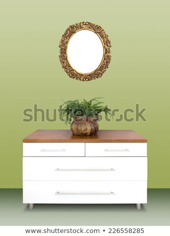 Modern chest of drawers and gilded Frame on wall Stock photo © smuki