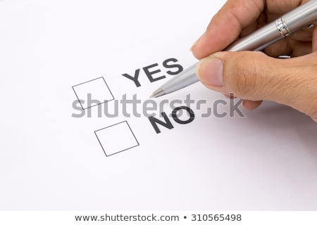 ihand with pen filling out a checklist   yes or no stock photo © zerbor